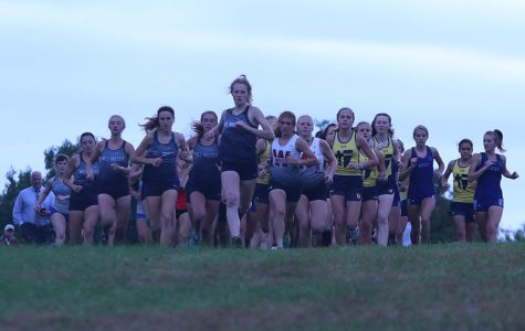 With a great start, junior Molly Ricker gets ahead of everyone and sets the pace for the race. The meet was held in Shawnee Mission Park Thursday, Oct. 10 with both the boys and girls getting first in their meets, and the girls also getting a perfect score.