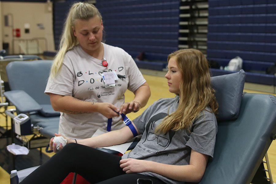 At+the+HOSA+sponsored+blood+drive+on+Wednesday%2C+Oct.+5%2C+senior+Rachael+Kinkade+prepares+to+donate+blood.