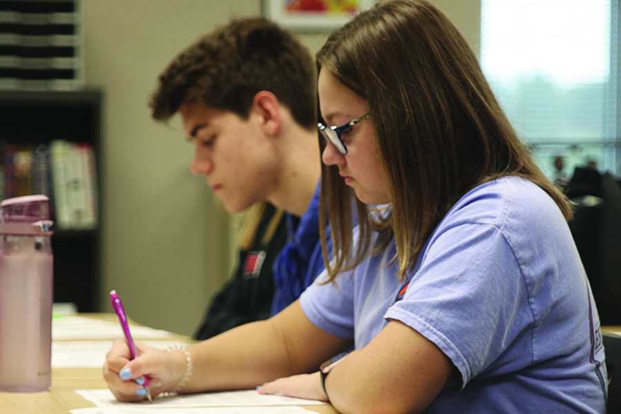 Taking a practice test in Jeff Wieland's ACT Prep class, junior Chloe Carr prepares for her standardized ACT test, which may replace the current Kansas State Assessment in upcoming years.