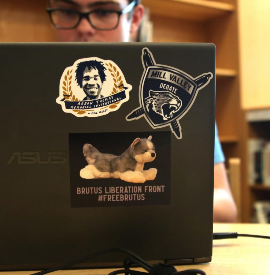 While junior Zachary Botkin debates, his opponents and judges can check out his collection of stickers, including a #FreeBrutus sticker.