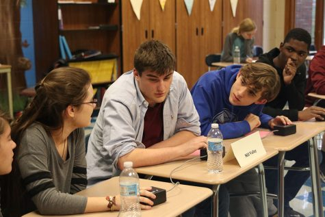 During round two against Eudora, the team discusses possible answers to a question Thursday, Oct. 24. The team ended the tournament at Tonganoxie with a 5-1 record.