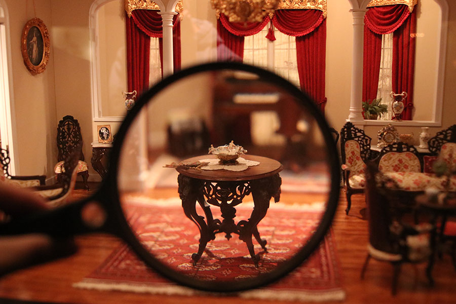 In the miniatures section in The National Museum of Toys and miniatures, a historic room features intricate pieces of furniture.