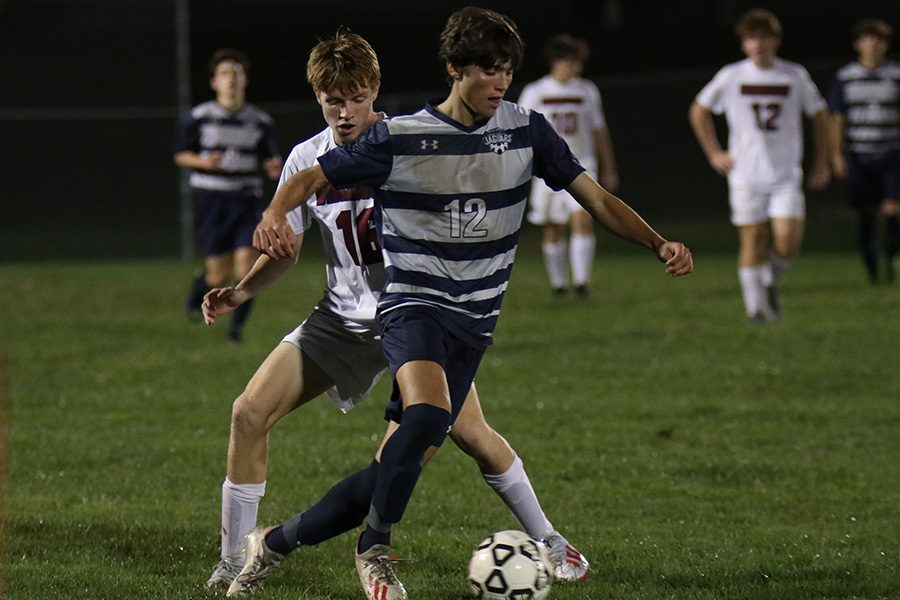 Senior Anthony Pentola blocks the other team's player from getting to the ball.
