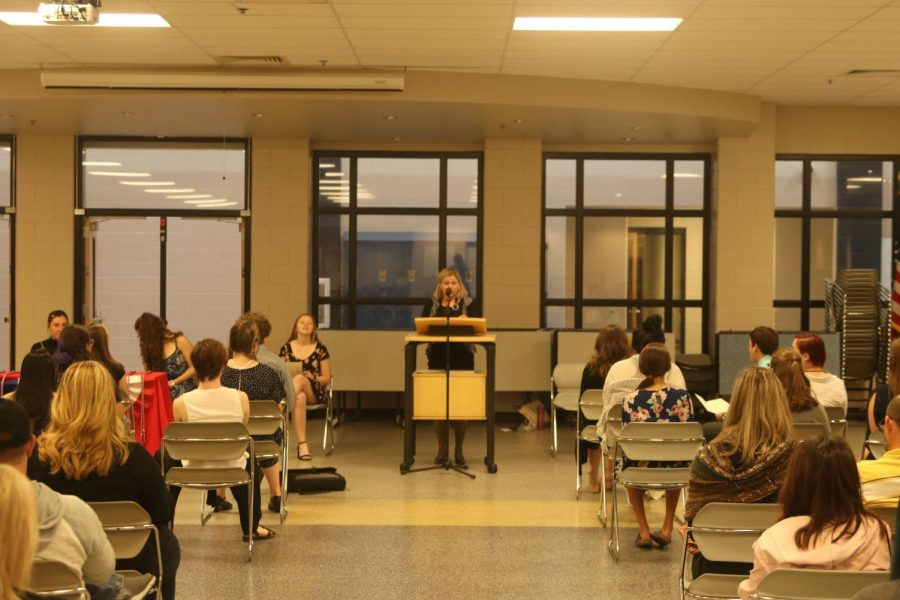 Ms. Highlander, a french teacher, gives a speech on what French National Honors Society is all about.