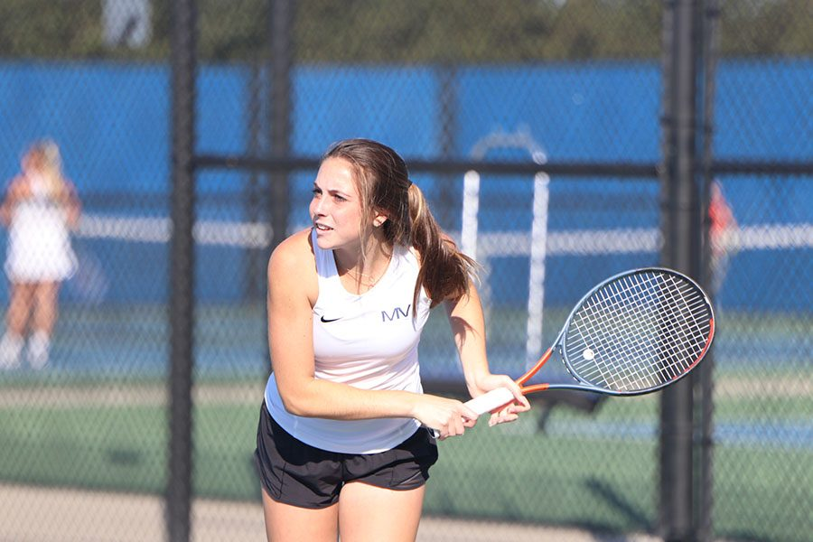 Junior Sophie Lecuru waits to hit the ball back at her opponent.