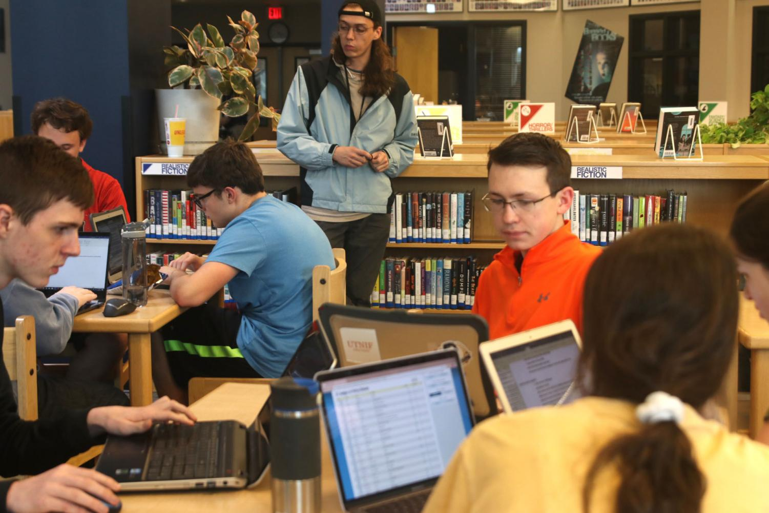 Debate gets ready for their trip to Oklahoma City, Oklahoma by gathering in the library to share information and strategies.