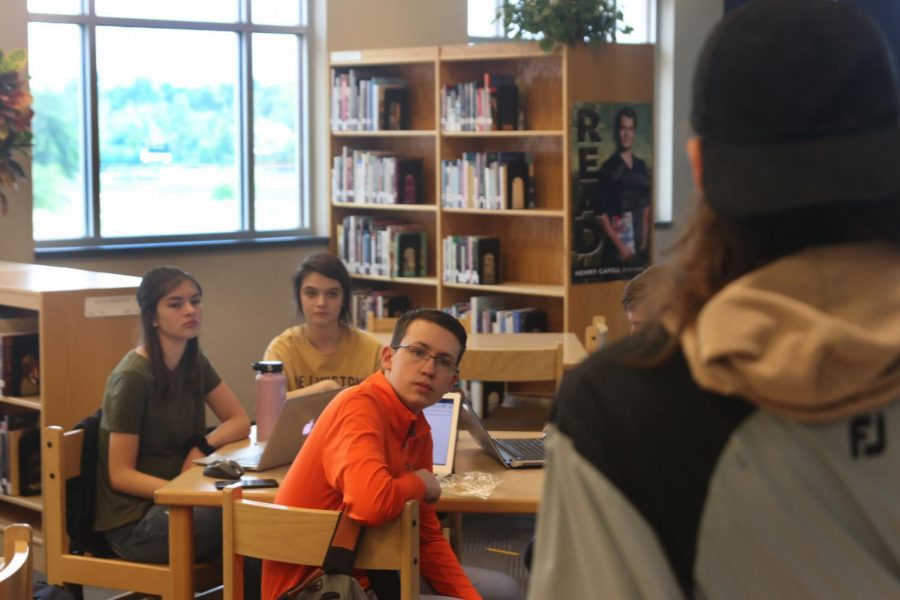 The debate team listen to there captain to gain info for there tournament