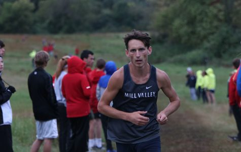 Running ahead of everyone, senior Darius Hightower leads the way in the Mill Valley Cat Classic Thursday, Oct. 10.  Hightower went on to break the school record and win the EKL championship on Thursday, Oct. 17 at JCCC.