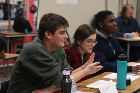 After correctly answering a language arts question, seniors Joan Downey and Noah Hookstra high five each other. The team placed second at Saint James Tuesday, Oct. 29.