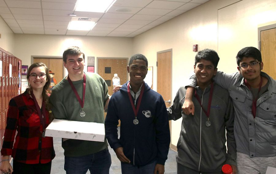 The five members of the Quiz Bowl team that competed at Saint James stand together after receiving medals for placing second.