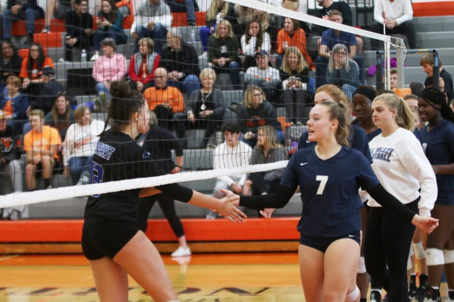 After the Jags win their third set against Olathe Northwest and advance to the next round of substate, the two teams meet at the net in a show of good sportsmanship.
