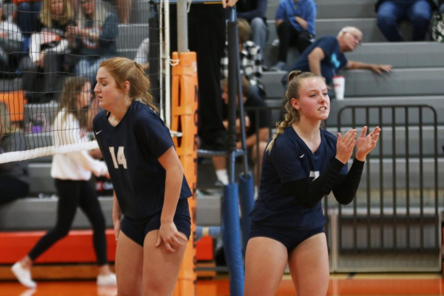 After scoring a point, sophomore Sydney Fiatte rallies the team before the next serve.