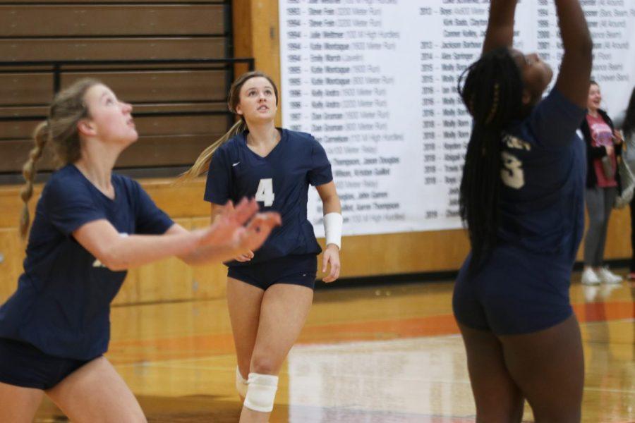 Eyes on the ball, senior Emma Fox runs forward to assist her teammates.