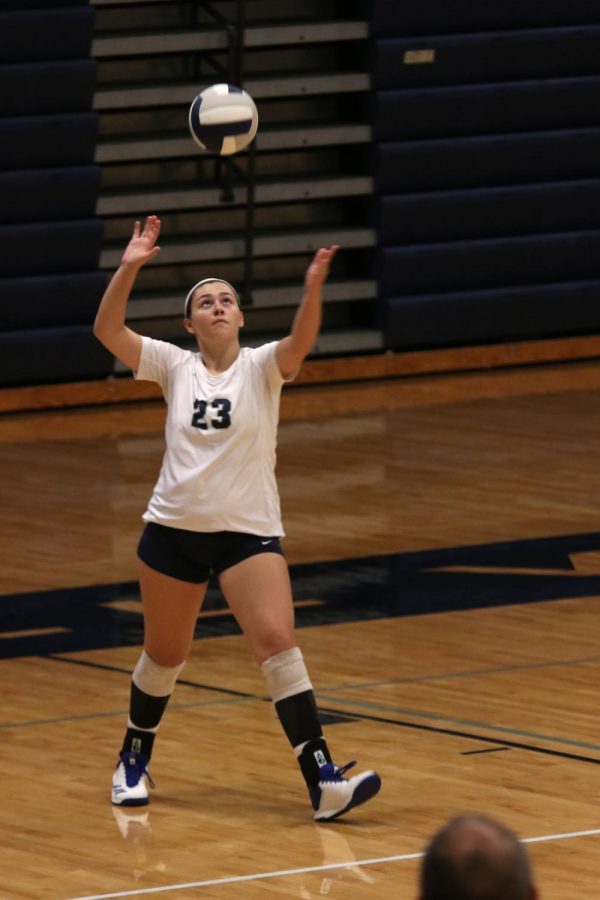 Eyes on the ball above her, junior Carlie Bradshaw prepares to serve.