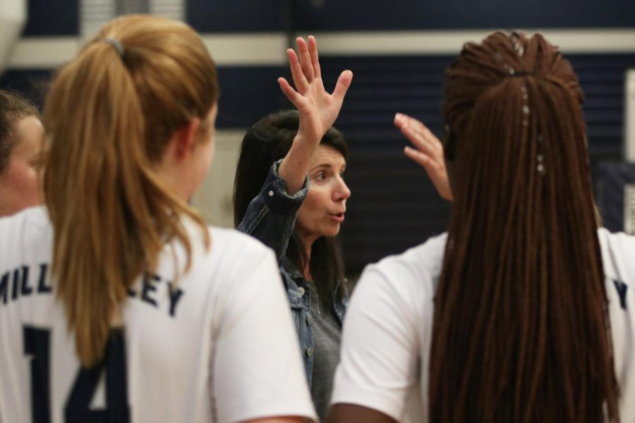 In the huddle, coach Debbie Fay raises her hand and motivates the team before the second set against Ottawa.