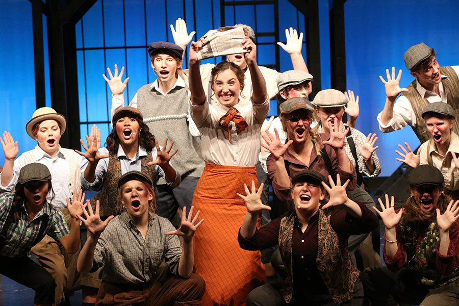Holding+a+newspaper%2C+senior+Analiese+Wilhauk+smiles+towards+the+audience.+The+cast+will+perform+shows+throughout+the+week+of+Saturday%2C+Nov.++9+through+Sunday%2C+Nov.+17.