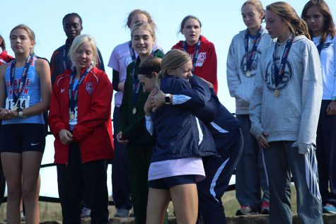 During the girls individual awards, sophomore Katie Schwartzkopf hugs senior Morgan Koca.