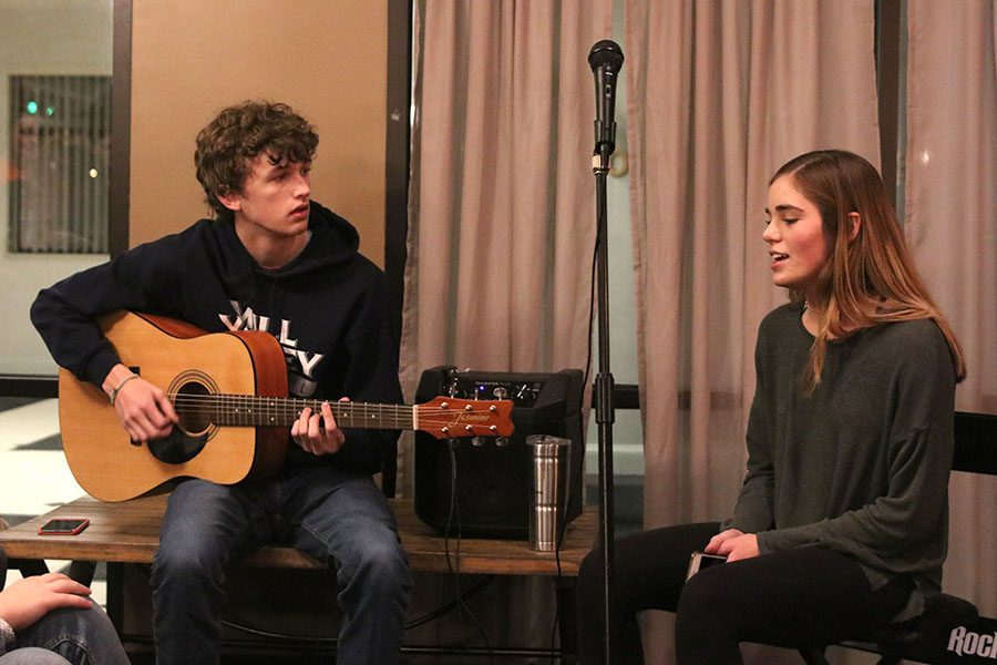 "As one of the early performers at the Open Mic Night, juniors John Fraka and Ellie Boone perform the song ""Valerie"" by Amy Winehouse Tuesday, Nov. 12."