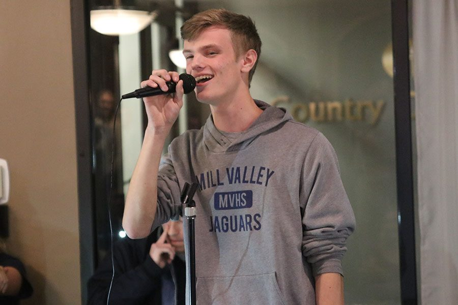 """At the StuCo hosted Open Mic Night, junior Lief Campbell performs the song """"Waving Through a Window"""" from the musical """"Dear Evan Hanson."""""""