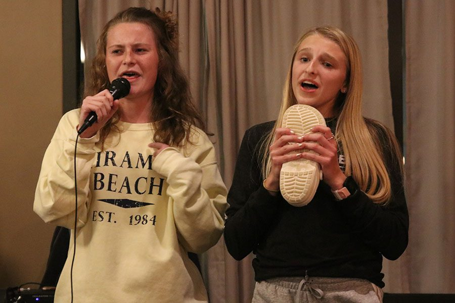 Side by side, sophomores Lauren Walker and Bridget Roy lip synch to the song