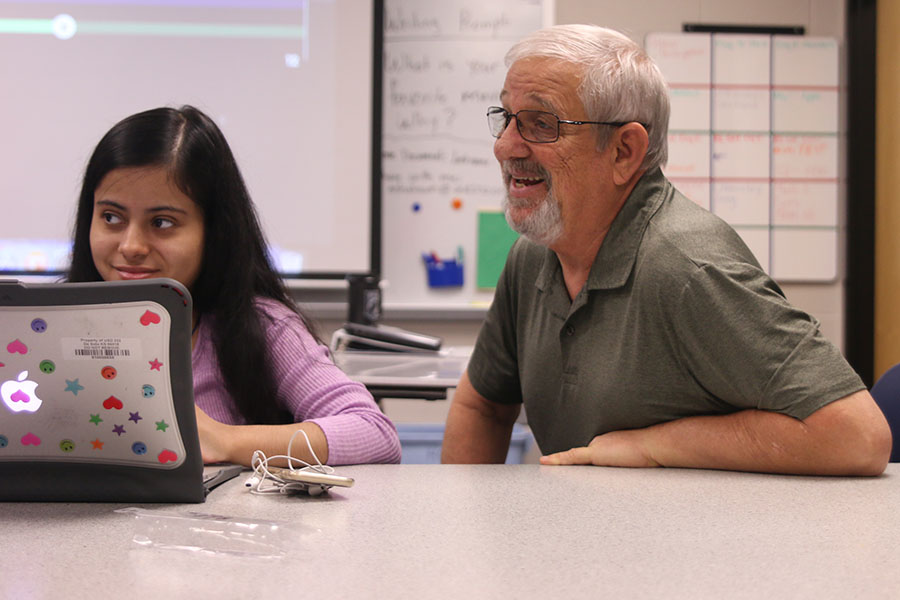 During class, para Mike Pierce helps the students he is assigned with study for their upcoming vocabulary test.