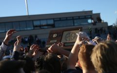 Football team brings home state title after 40-31 shootout victory over Wichita Northwest