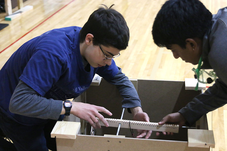 In addition to a written test, junior Alex Whipple and senior Srikar Turaga adjust their device for