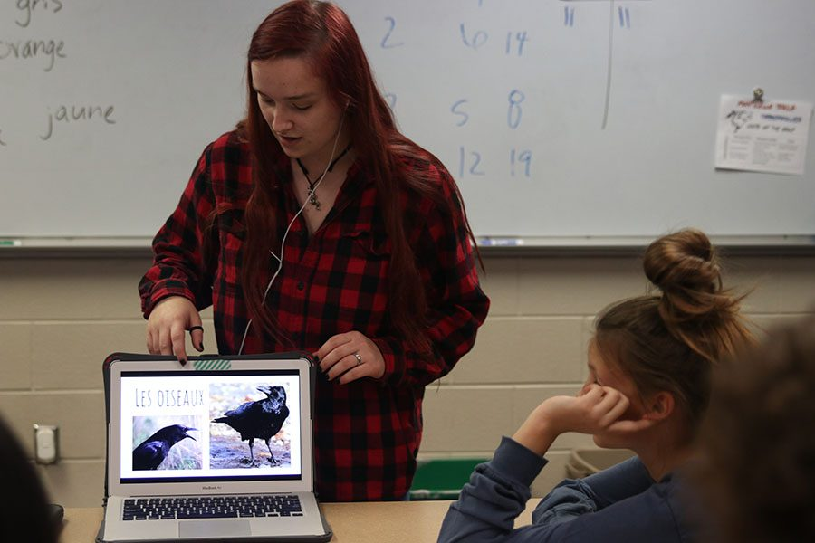 While going through a slideshow on her laptop, junior Austyne January teaches students the French word for bird. French IV and French NHS students travelled to Monticello Trails Middle School Tuesday, November 5.
