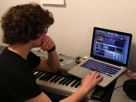 Using his personal computer, Jon Pursell works on creating his own music on a daily basis.