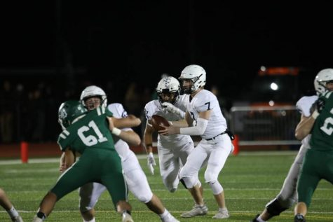 Football improves to 2-0 in district play, secures spot in playoffs