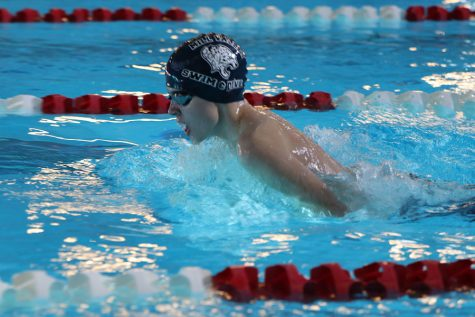 Catching his breath, freshmen Alec Forristal swims in the boys 200-yard breaststroke relay. The team placed fourth at Lansing Saturday, Nov. 4.