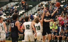 Gallery: Boys basketball defeats De Soto 47-42