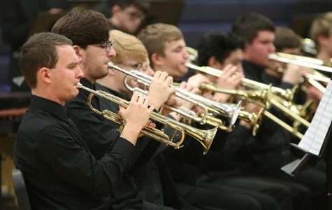 At the winter concert Wednesday, Dec. 4, senior Sam Greenup plays