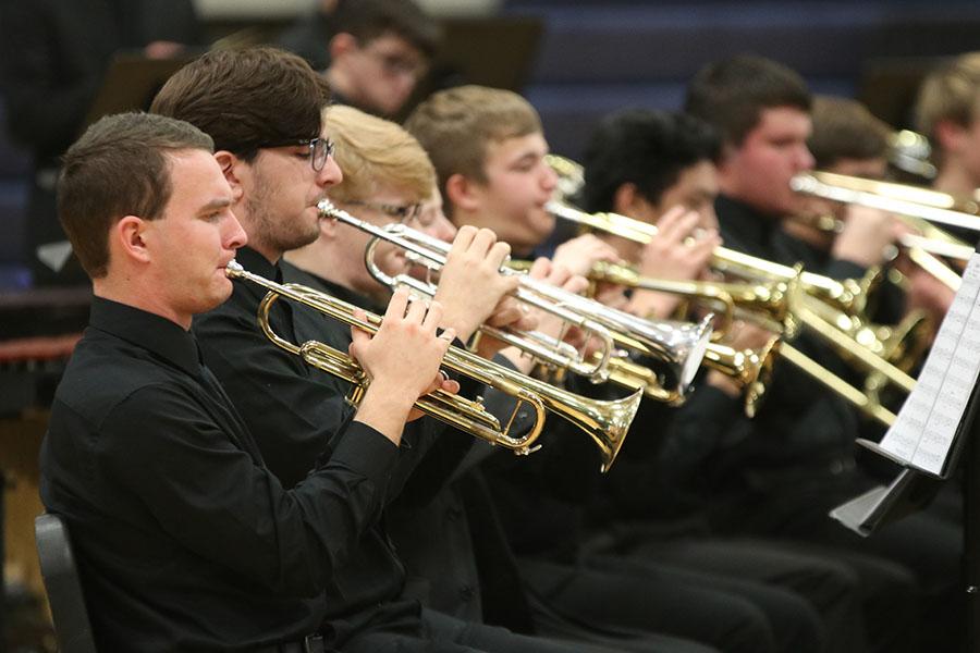At+the+winter+concert+Wednesday%2C+Dec.+4%2C+senior+Sam+Greenup+plays+%22Sunburst%22+on+his+trumpet.