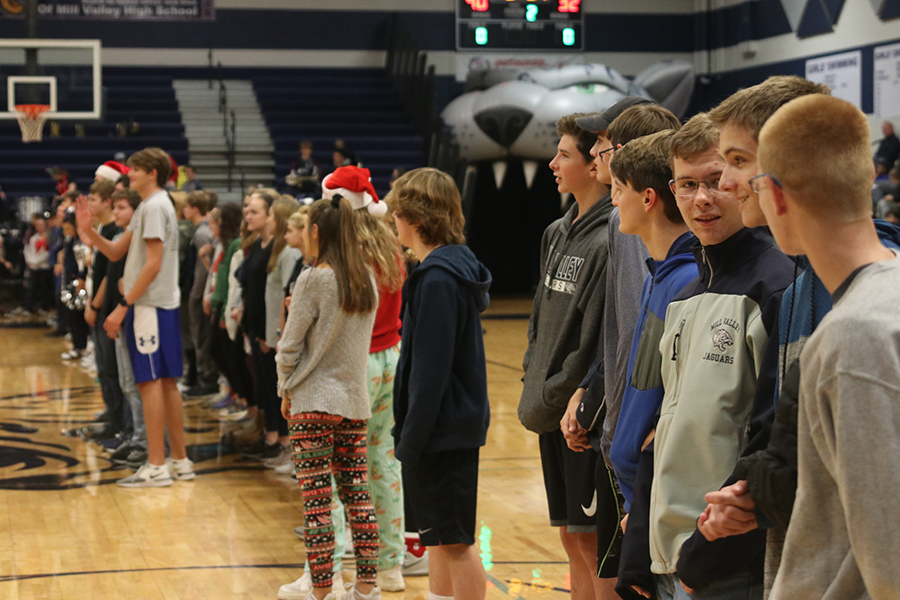 Students+lined+the+gym+to+be+recognised+for+making+it+on+the+Honor+Roll.+Students+whose+GPAs+exceeded+3.7+had+the+opportunity+to+be+recognized+at+the+basketball+game+Friday%2C+Dec.+6.