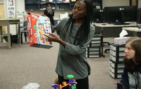 During the Society of Women Engineers meeting Wednesday, Dec. 4, founder Courtney Mahugu gives the members a task where they must put together a functioning Marble Run set without verbally communicating.