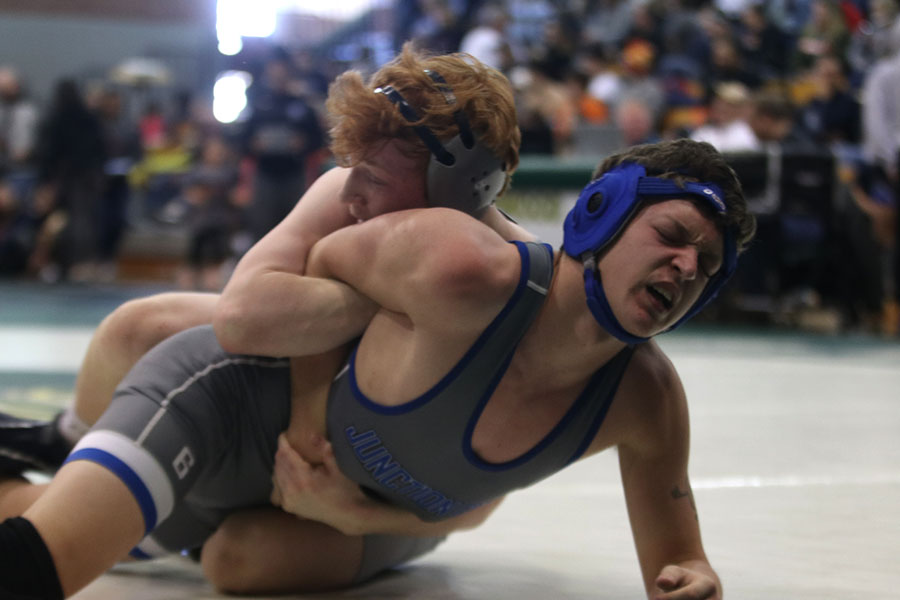 Forcing his opponents arm back, junior Carson Dulitz pulls him back in an attempt to flip him.