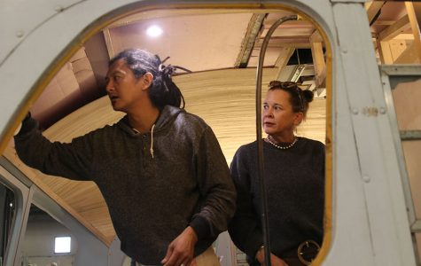 Tom and Kristen Huang work on the bamboo ceiling paneling of the bus.