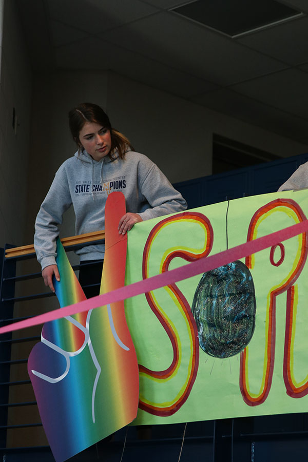 Centering her class sign, sophomore class president Logan Pfeister directs her classmates on Sunday, Jan. 5.