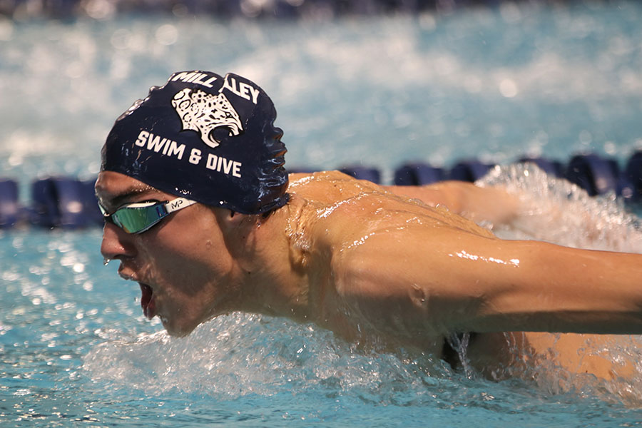 Competing+in+the+200-yard+IM%2C+junior+Cole+McClure+swims+butterfly+down+the+lane.+The+boys+swim+team+placed+eighth+overall+at+the+Shawnee+Mission+Invite+Saturday%2C+Jan.+25.%0A