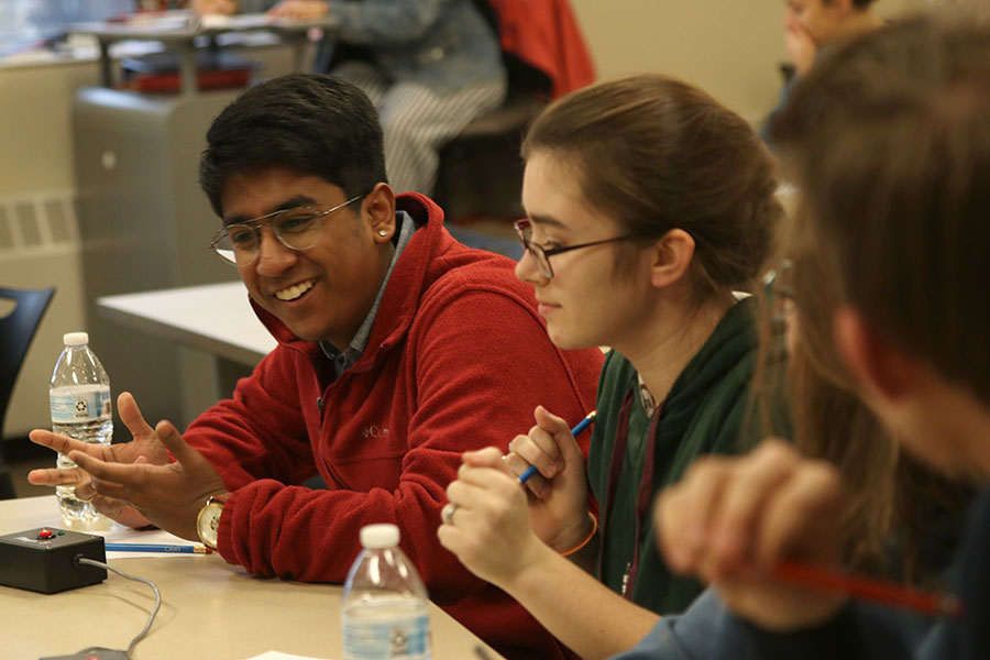 Leaning in, senior Srikar Turaga discusses the question with his teammates. The team went 3-3 during the Quiz Bowl tournament at Lansing Thursday, January 16.