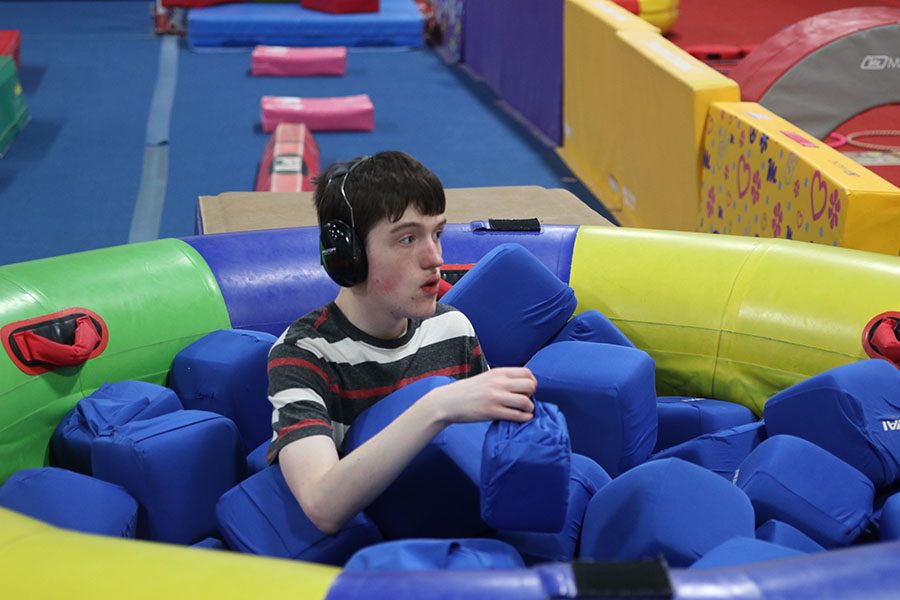 Sitting+in+a+foam+pit+sophomore+John+Carl%2C+plays+with+the+foam+cubes+at+Pinnacle+Gymnastics+on+Thursday%2C+Jan.+23.+