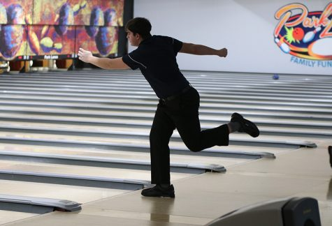 Leaning forward, junior Devin Kuhlman watches the ball roll down the lane. The bowling team claimed first in every category at the St. James meet Thursday, Jan 23.