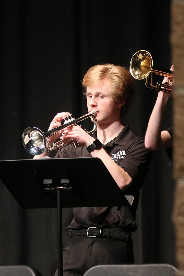 Eyes focused on his music, senior Andrew Tow plays his trumpet.