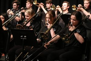 Jazz band performs concert showcasing seven different music pieces