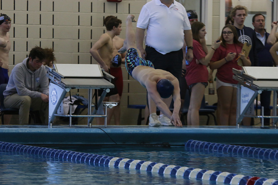 Diving in, freshman Anthony Molinaro competes in the 100-yard butterfly. Molinaro placed 20th in the event.