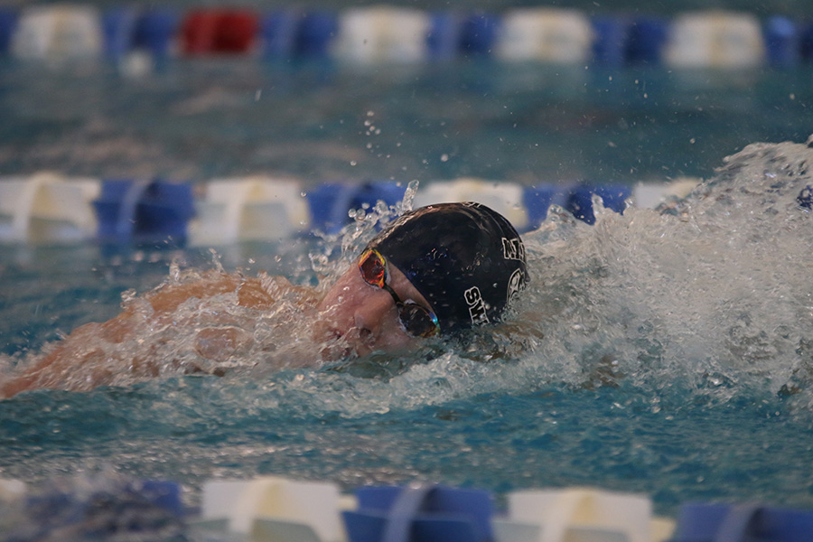 Senior Avery Lawson swims in the 400-yard freestyle relay.