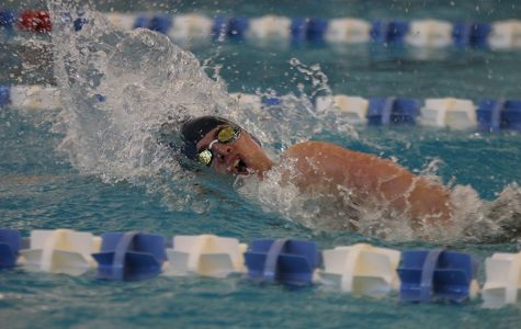 Coming up for air, junior Noah Collins competes in the 400-yard freestyle relay at the state meet on Friday, Feb. 21 and Saturday, Feb. 22. The team placed 9th overall at state.