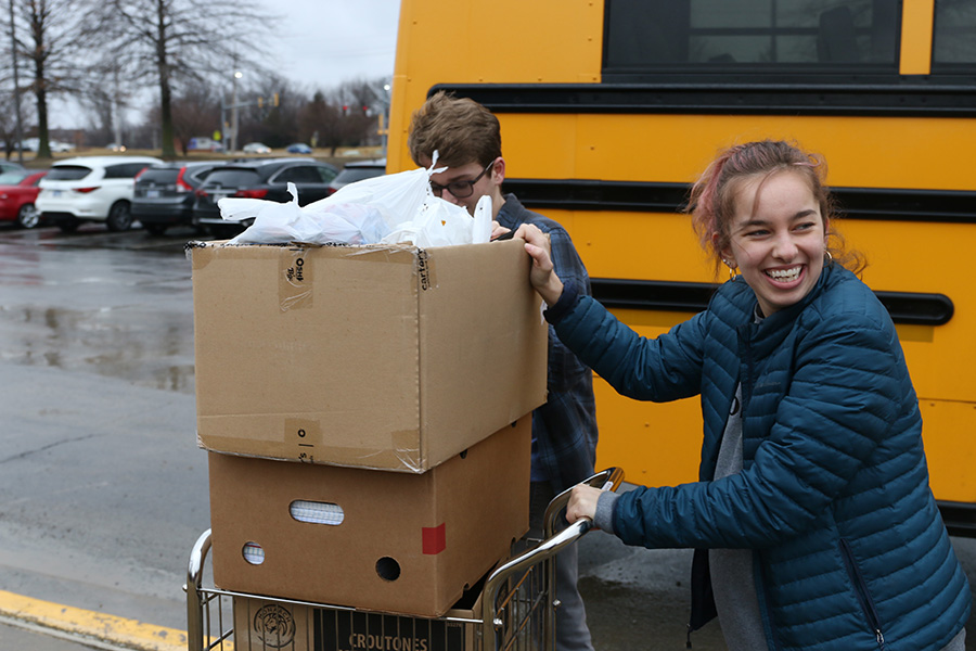 Taking+supplies+out+to+the+car%2C+senior+Belle+Baker+leaves+Monticello+Trails+with+the+donations+collected+from+the+Youth+for+Refugees+school+supplies+drive+held+from+Tuesday%2C+Feb.+18+to+Friday%2C+Feb.+21.