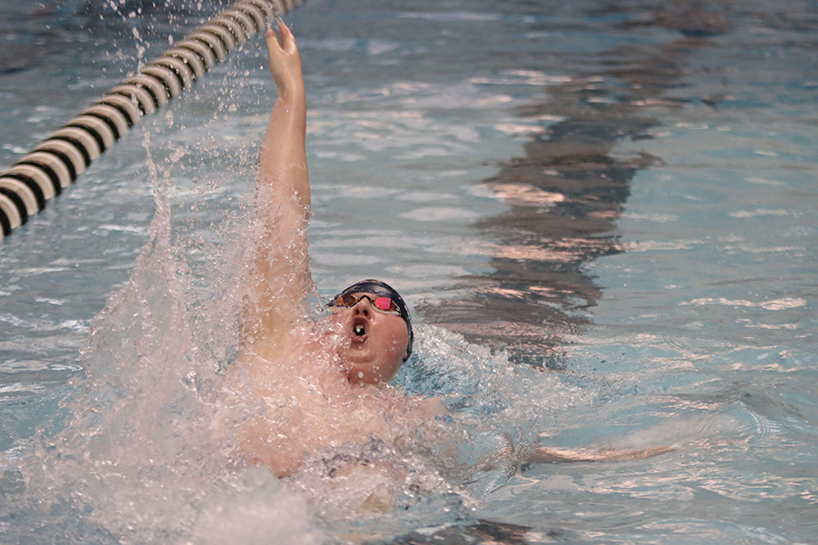 Senior Logan Myers swims in the EKL 100-yard backstroke finals.